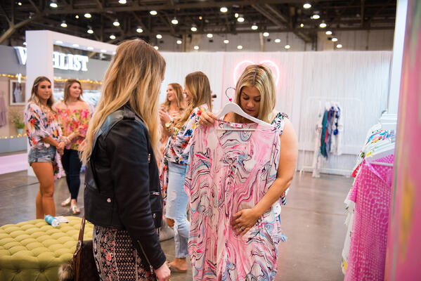 Ashley consulting with one of the 3,000 independent retailers that The Boutique Hub helps daily