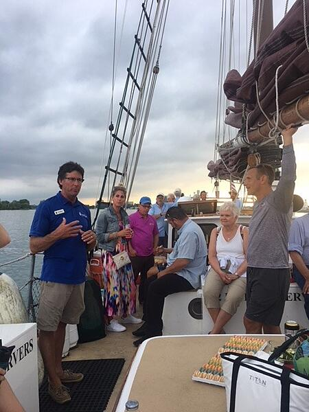 Fred Sitkins, and Roy Lamphier, founder of Excelerate America, addressing the participants of the school program last month on the Detroit River.